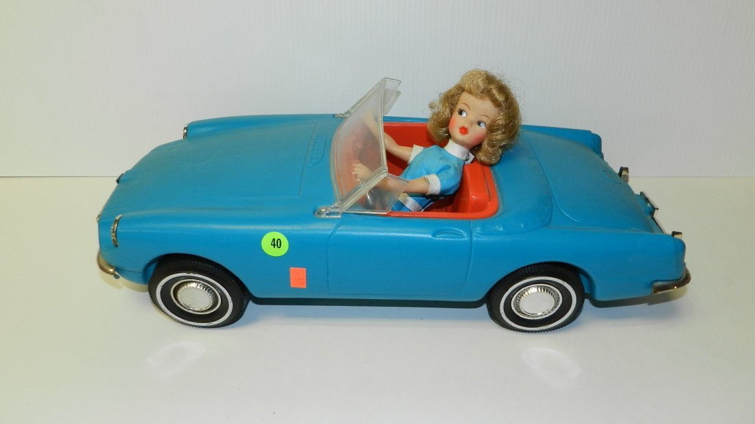 40: mid century toy car with doll