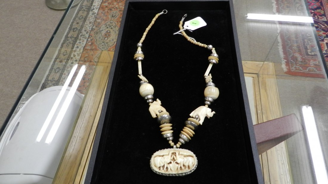 1: wonderful Ivory and silver carved elephant necklace