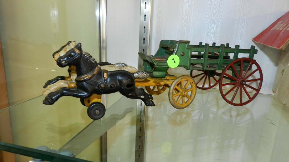 7: antique cast iron toy horse and wagon
