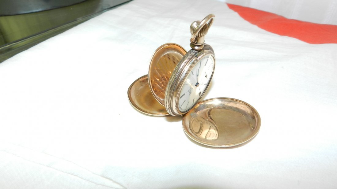 12: antique gold plated pocket watch