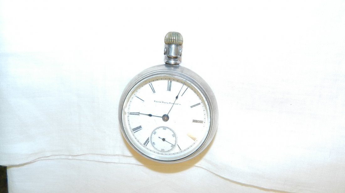 13: antique silver cased pocket watch as seen