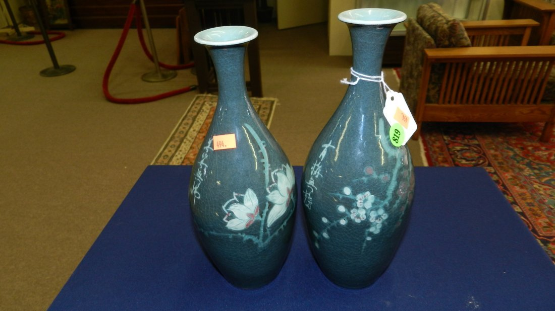 819: 2 piece Asian porcelain painted vases, marked