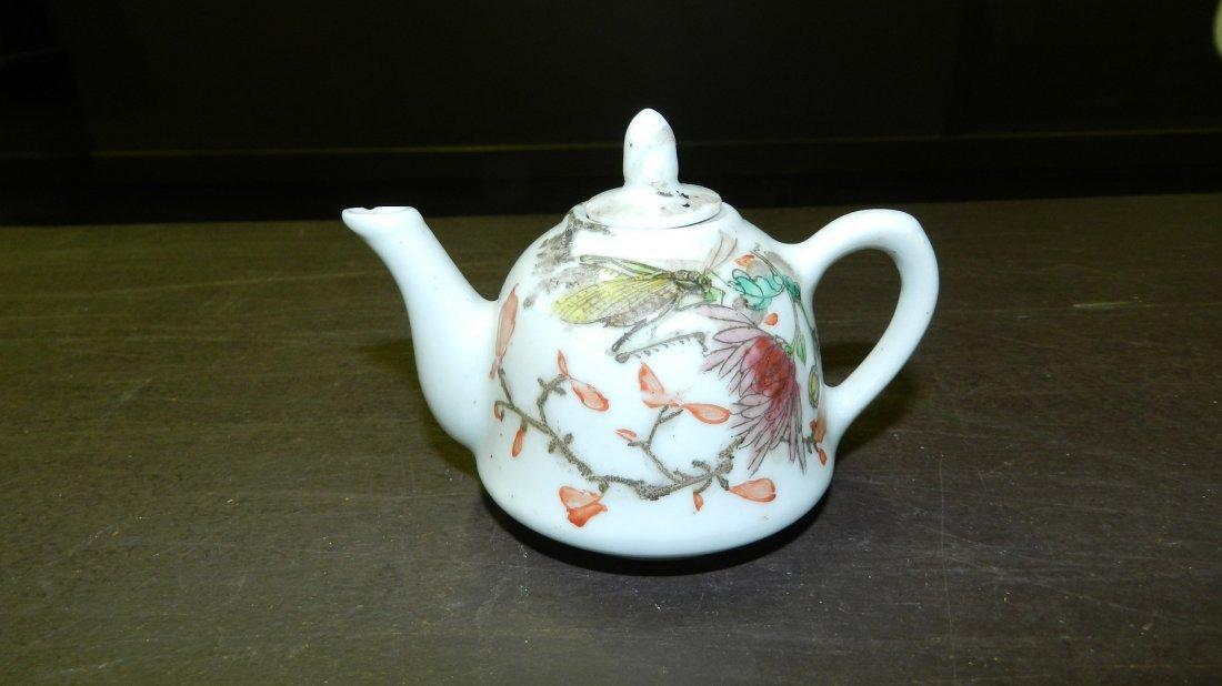 355A: Chinese miniature tea pot w/ grasshopper design,
