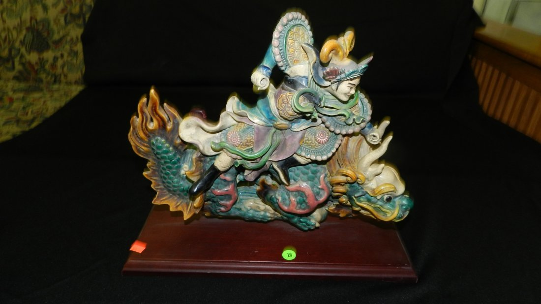 16: clay Asian warrior on dragon (applied to a stand) 1