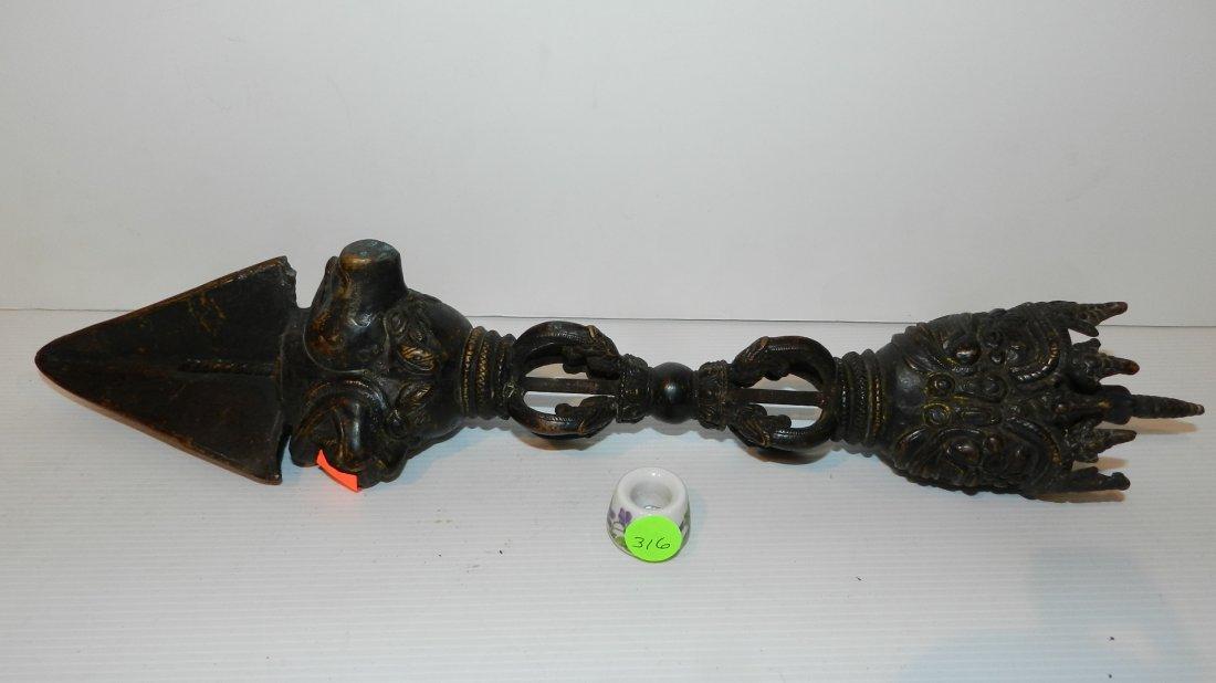 6) stunning bronze Asian dagger with Grotesque mask, an