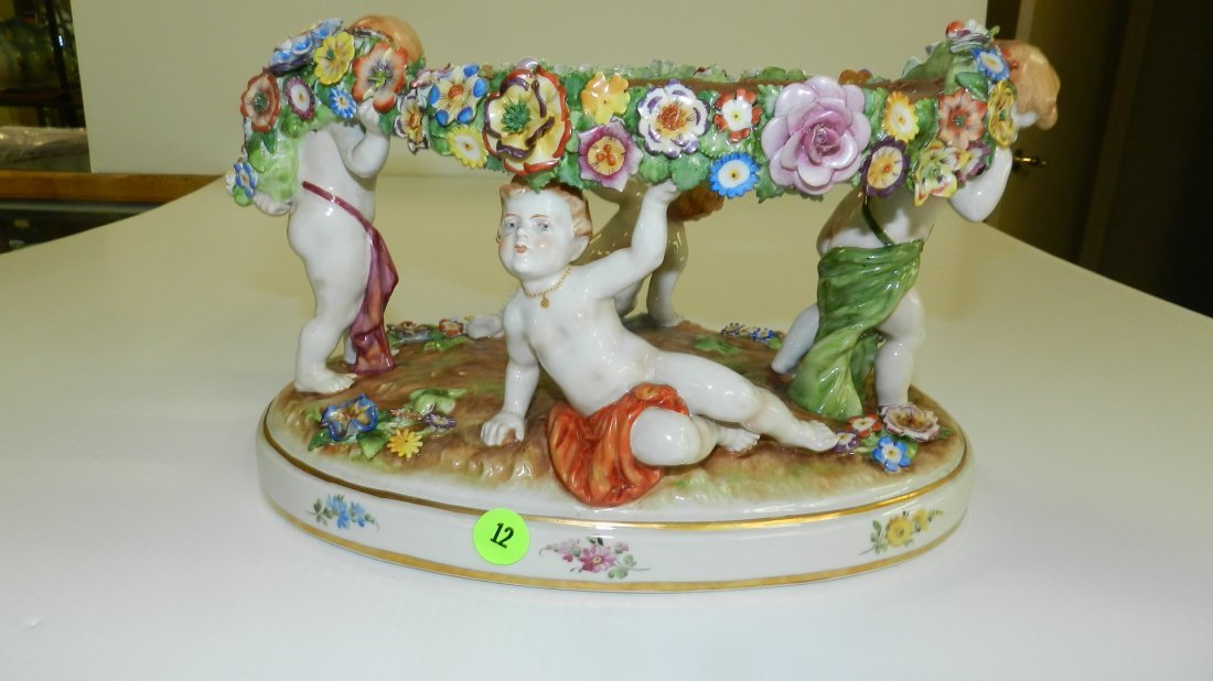 lovely hand painted antique porcelain putti figural cen