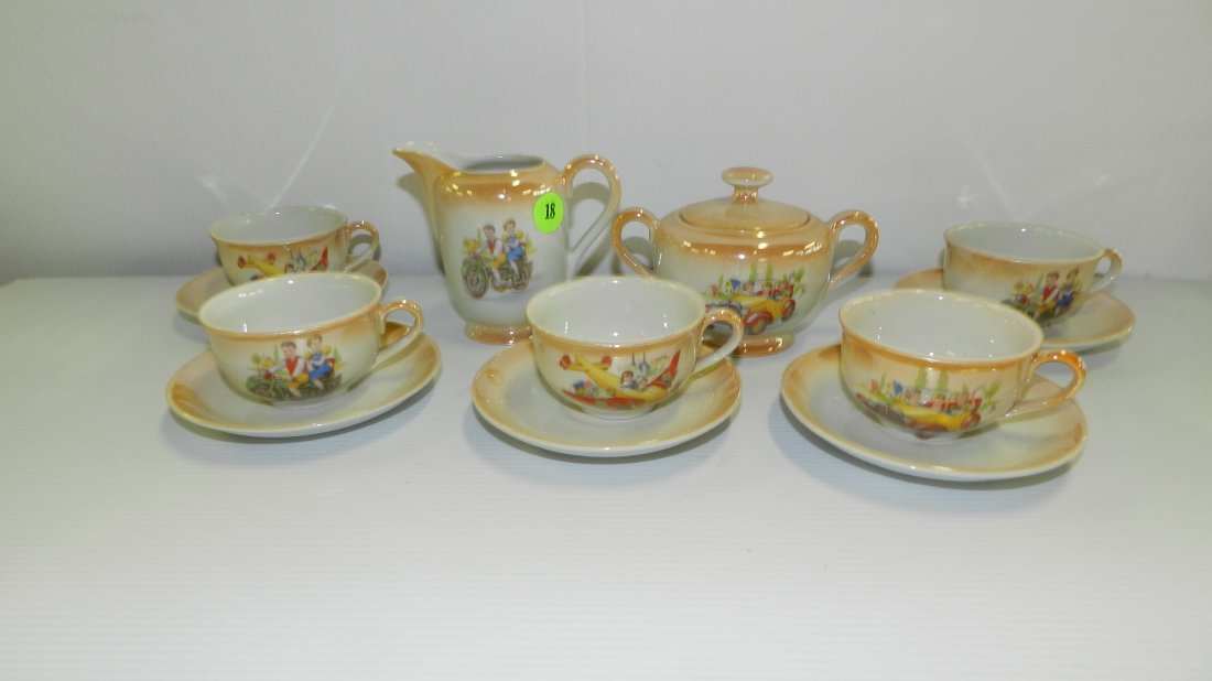 Rare child's Litho tea set w/planes, cars, motorcycles