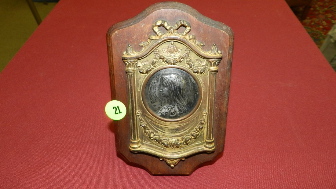 Antique metal cast frame applied to wood with Sterling?