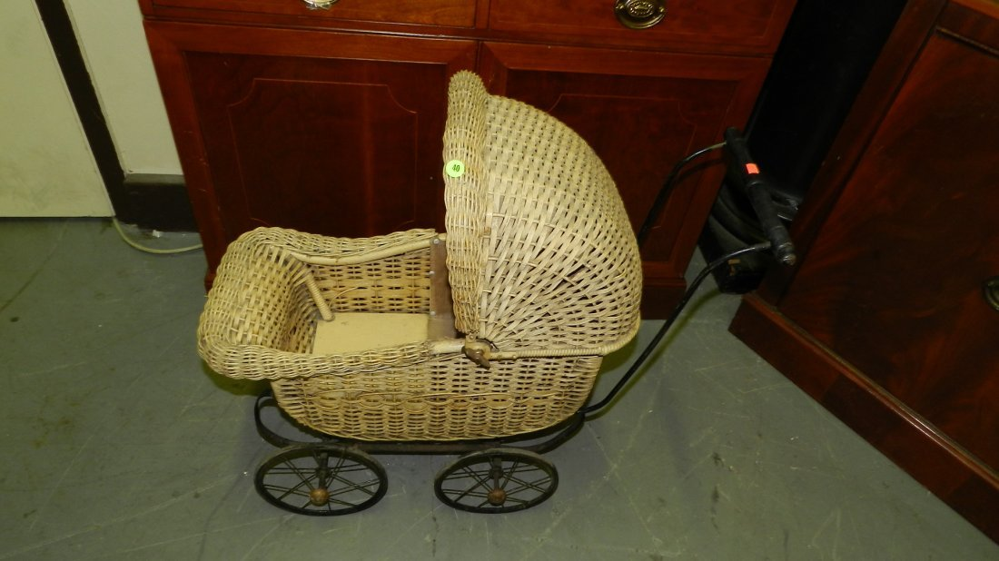 Vintage wicker child's baby buggy. SSR