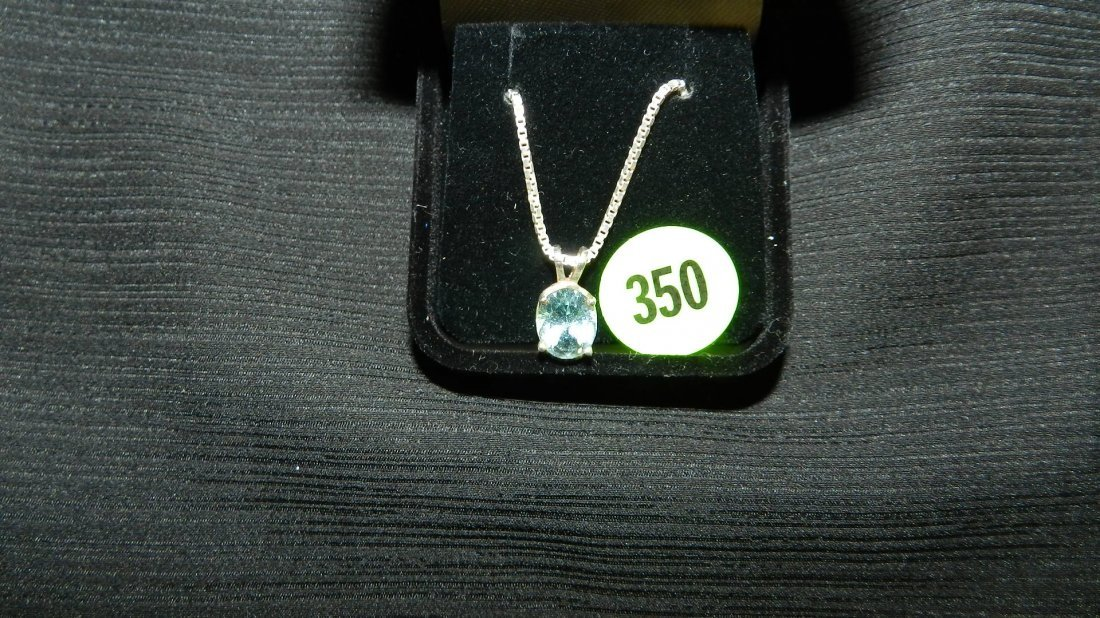 beautiful ladies sterling necklace and charm with cut