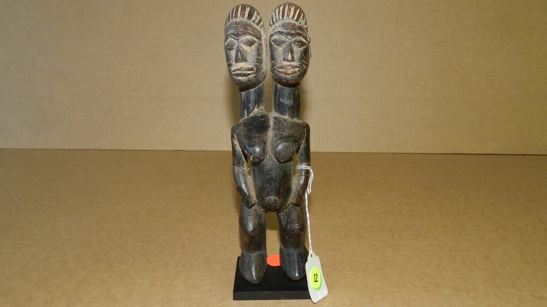 5604) African carved Two headed female figure on base,