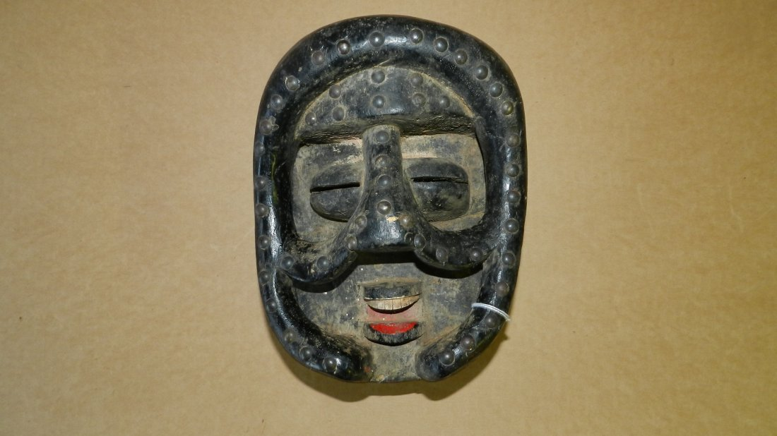 3419) Africn carved and painted mask with tack work