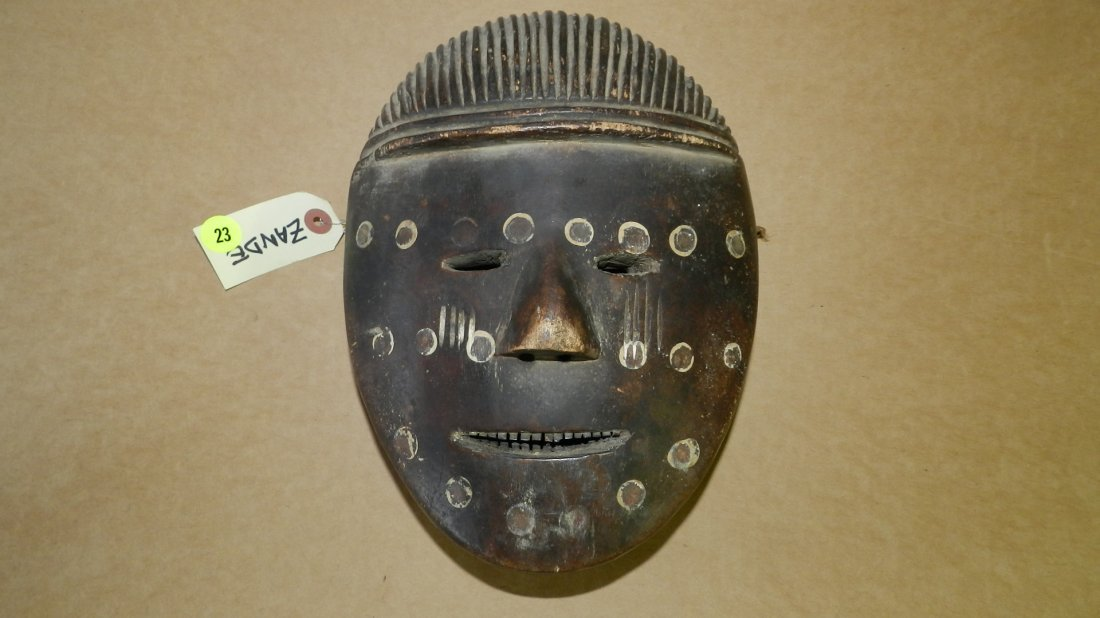1779) African oval shaped mask dark with white rimmed