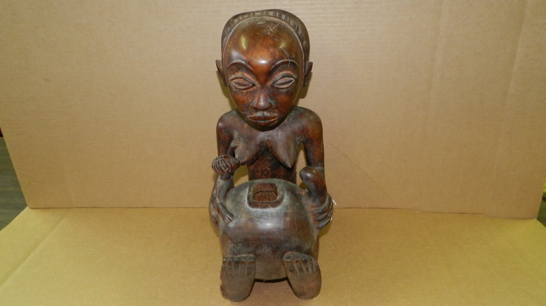 1851) African carved LUBA seated female figure, holding