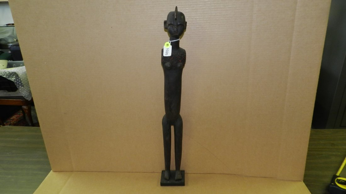 1026) East African carved standing female pounder