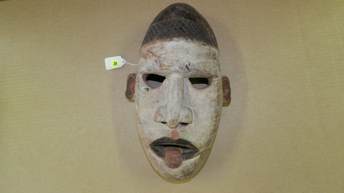 4022) West African carved white faced mask with