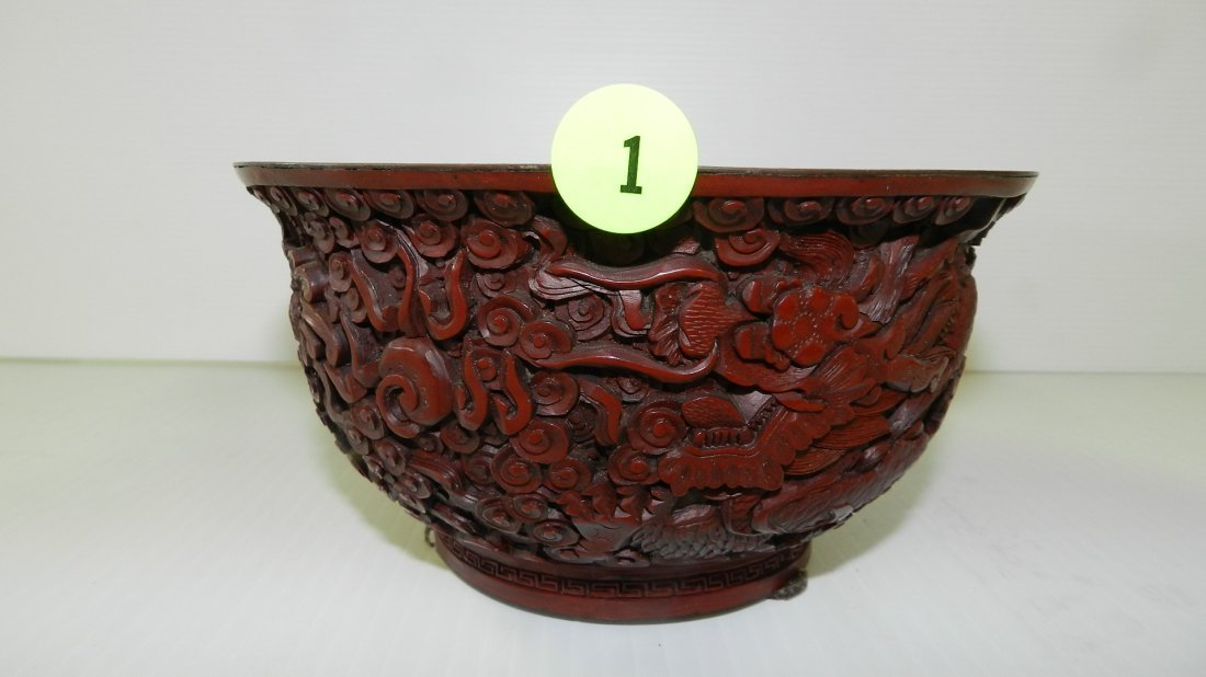 lovely Asian carved cinnabar bowl with dragon scene,