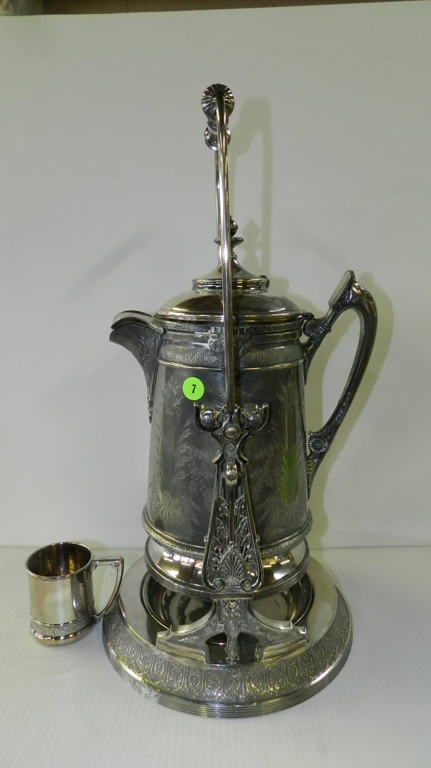 fancy silver plated Victorian tipping water pitcher on