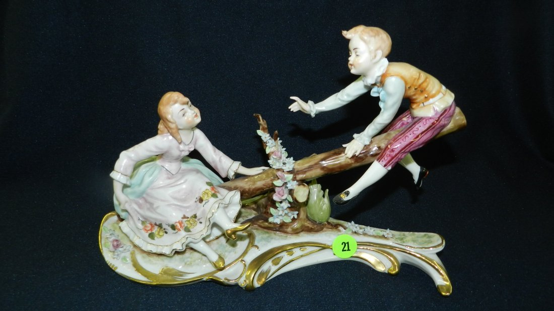 lovely porcelain figurine of young boy and girl on