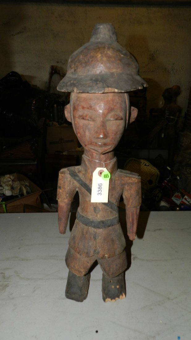 3386) carved Colonial figure w/pit helmet. Damaged foot