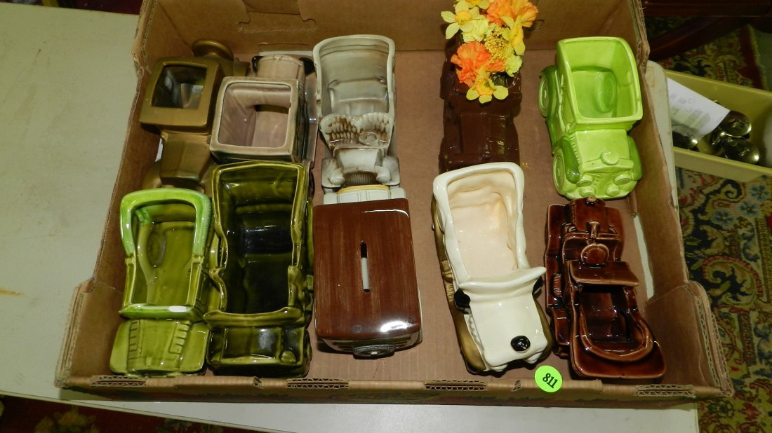 box of vintage pottery car planters