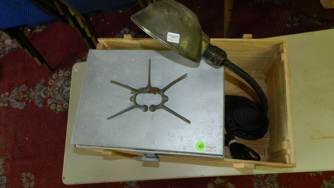 box of Primitives with desk lamp / milk box