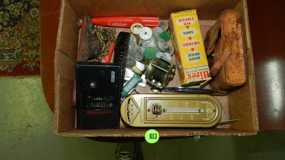 box of collectibles with tokens etc