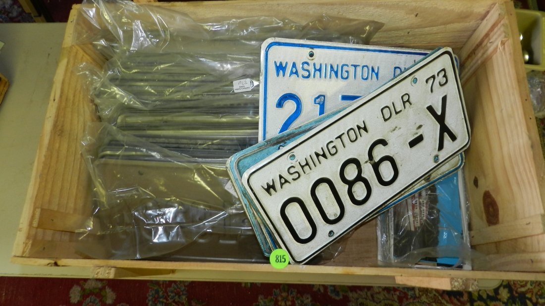 large box of vintage auto license plates