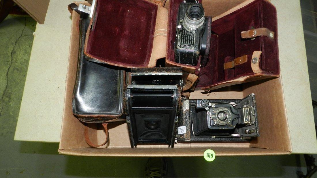 436?) box of vintage camera's