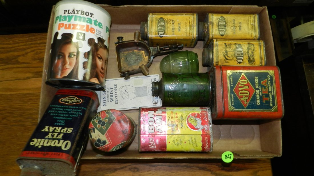 box of Primitive items including, advertising tins