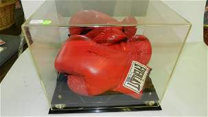 16) Matching pair of boxing gloves, autographed by the
