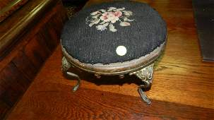 Antique small cast metal and needlepoint footstool