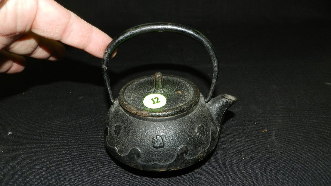 Antique Chinese single cast iron tea pot with ocean