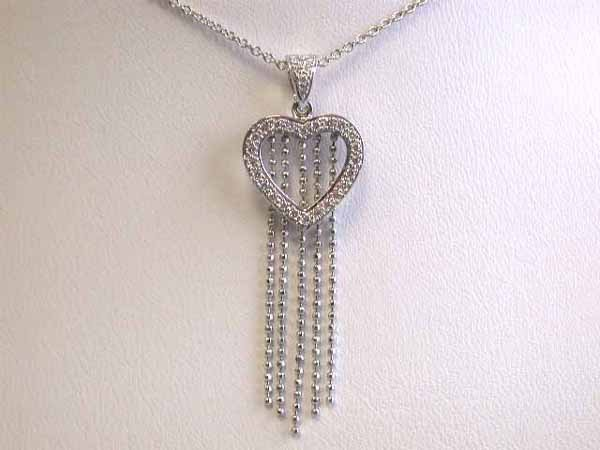 12: Gold Necklace with Heart Pendant