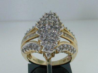 7: 10K Two-tone Gold Diamond Baguette Ring.