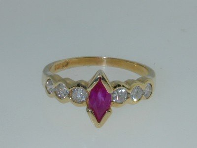 21: 14K Yellow Gold  Ruby & Diamond Ring