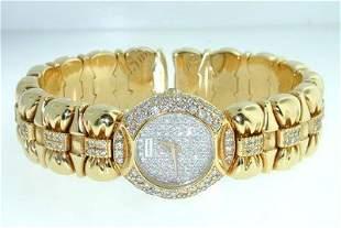 326: Juvenia 18K Yellow Gold, Diamond Bangle Watch.