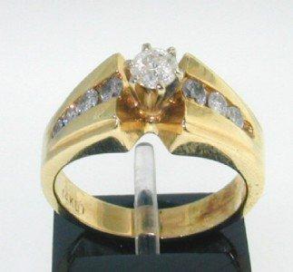 5: 14K Yellow Gold Diamond Ring.