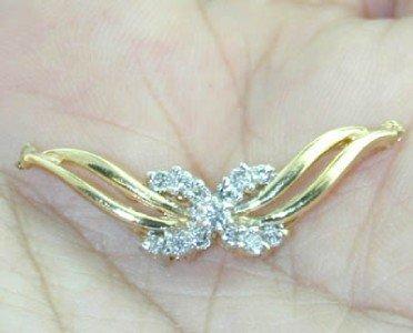 11: 14k Yellow Gold Diamond Pendant