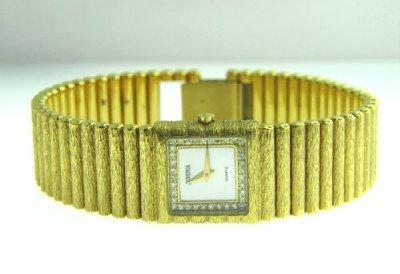 283: Juvenia 18K Yellow Gold, Diamond Watch.