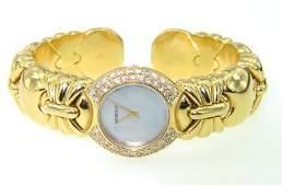 505: Moboco 18K Yellow Gold, Diamond Bangle Watch.