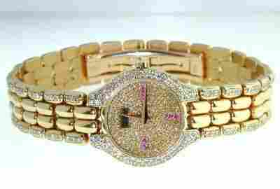 391: Juvenia 18K Yellow Gold, Diamond & Ruby Watch.