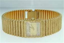 261 Juvenia 18K Yellow Gold Diamond Watch