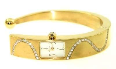 258: Milus 18K Yellow Gold Diamond Bangle Watch