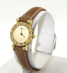 17: Tiffany & Co 18K Yellow Gold, Brown Leather Strap W