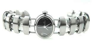 13: Milus Stainless Steel Bangle Watch