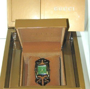 4B: Gucci Stainless Steel  Watch.