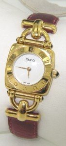 4B: Gucci Stainless Steel Leather Strap Watch