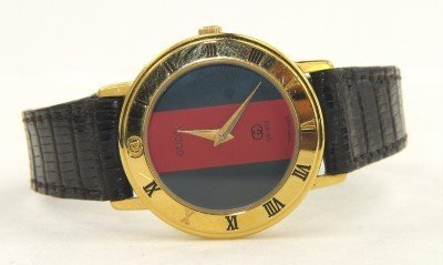 12A: Gucci Gold Plated Leather Strap watch