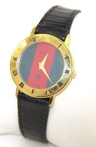 4A: Gucci Gold Plated Leather Strap watch